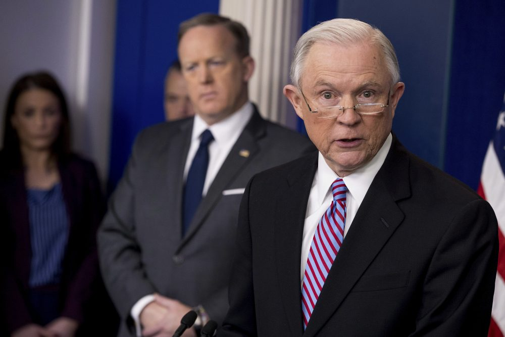 Attorney General Jeff Sessions, right, accompanied by White House press secretary Sean Spicer, talks to the media Monday. (Andrew Harnik/AP)