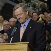 Pictured: Mass. Gov. Charlie Baker becomes emotional as he speaks after signing sweeping legislation aimed at reversing a deadly opioid addiction crisis, during a signing ceremony at the Statehouse, Monday, March 14, 2016, in Boston. (Elise Amendola/AP)