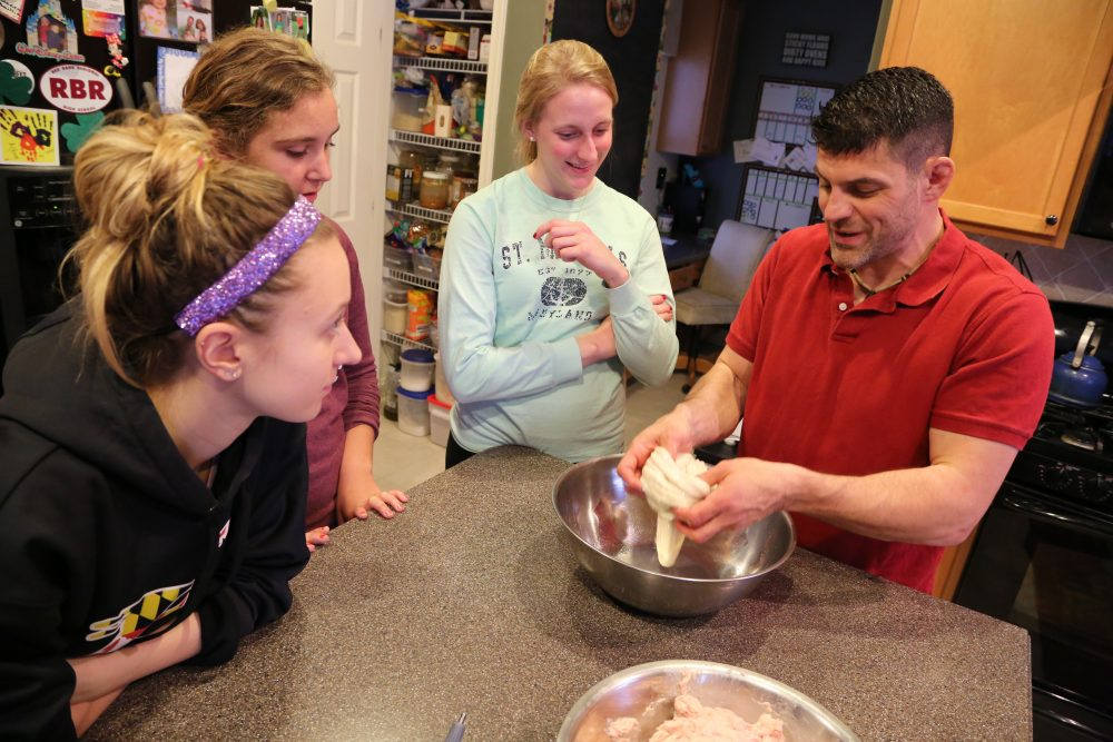 As part of his Food, People, and the Planet class, Bill Schindler invites students to work with every part of the animal to prepare the meal. (Courtesy Washington College)