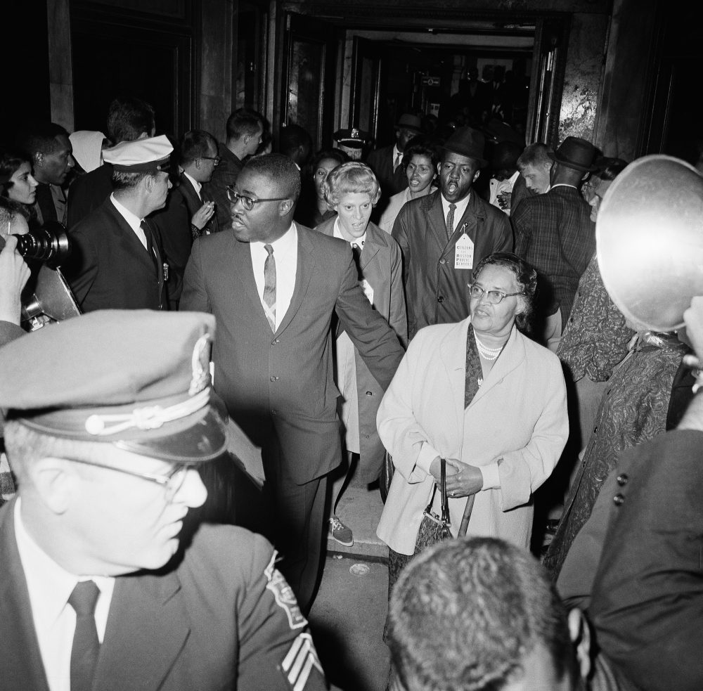A group of 45 members of the NAACP led by Boston leader Kenneth Guscott, left, leave headquarters of the Boston School Committee on Sept. 7, 1963, after staging a three-day sit-in protesting what they term de facto segregation in Boston schools. Guscott walks with Melnea Cass, right, who was president of the NAACP's Boston branch before him. (AP/FCC)