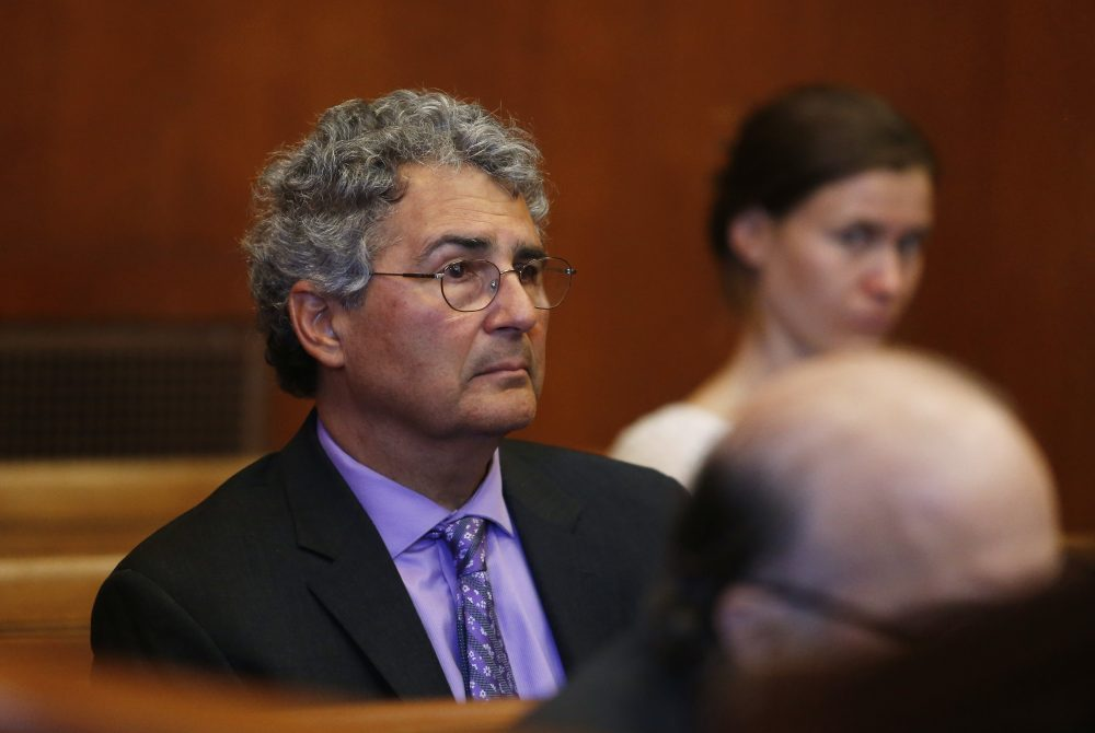 Dr. Roger Kligler sits in Suffolk Superior Court in Cambridge, Mass., during a hearing Wednesday on March 8 in a lawsuit filed by him seeking a judge's ruling that current state law allows physicians to offer aid-in-dying medication to terminally ill adult residents. (Jessica Rinaldi /The Boston Globe via AP, Pool)