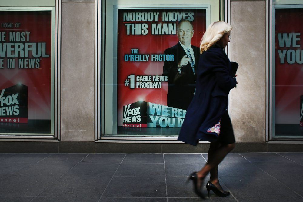 An advertisement for Bill O'Reilly's top-rated Fox News show is displayed in the window of the News Corporation headquarters on April 5, 2017 in New York. (Spencer Platt/Getty Images)