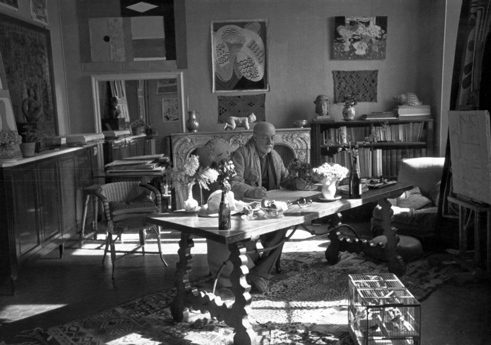 Matisse with his collection of Kuba cloths and a Samoan tapa on the wall behind him as photographed by Henri Cartier-Bresson at the artist's home and studio in Vence, France, in 1944. (Courtesy Museum of Fine Arts, Boston)