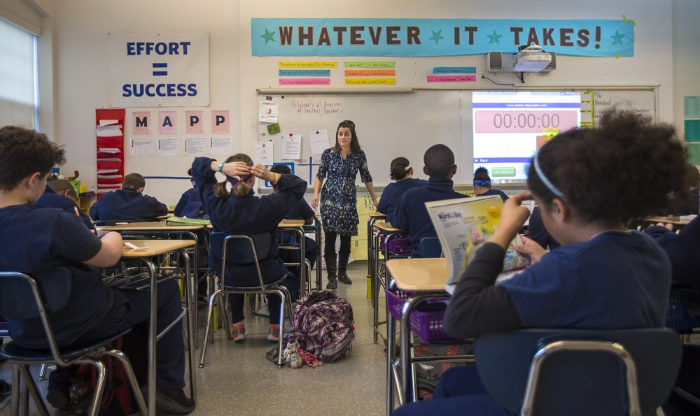 In front of her students, Boston Collegiate Charter School teacher Bridget Adam acts as more of a facilitator or moderator than traditional teacher. (Jesse Costa/WBUR)