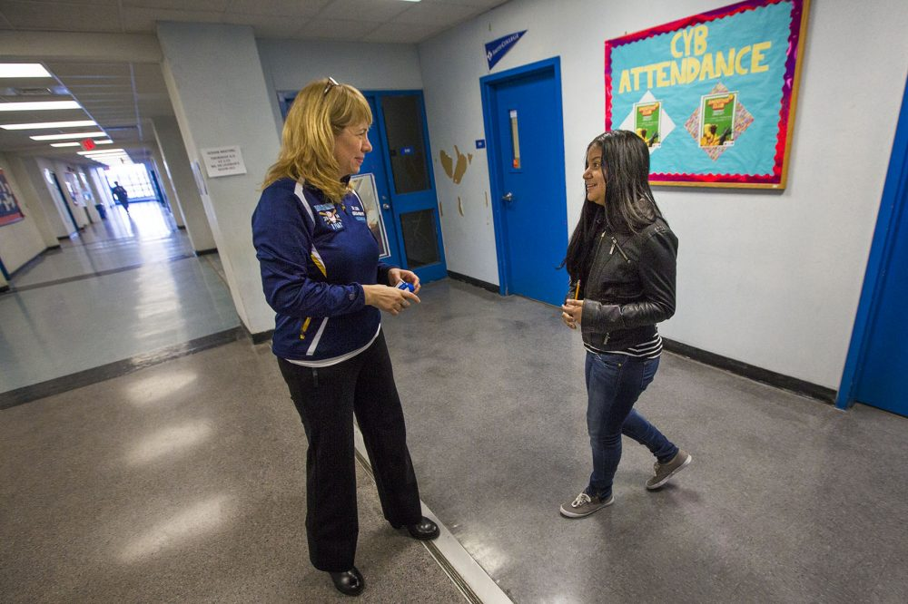 Headmaster Ligia Noriega-Murphy speaks with a student in the hallway in between classes. (Jesse Costa/WBUR)