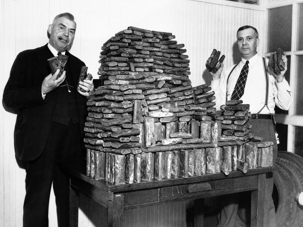 Agents Chris Hansen and H.A. Moodie hold seized opium in Los Angeles on April 22, 1935. Ingeniously hidden under a load of oranges in the rear of an auto driven by a Chinese man, this store of opium, valued at $40,000, was seized by federal narcotic officers. The driver was arrested. (AP)