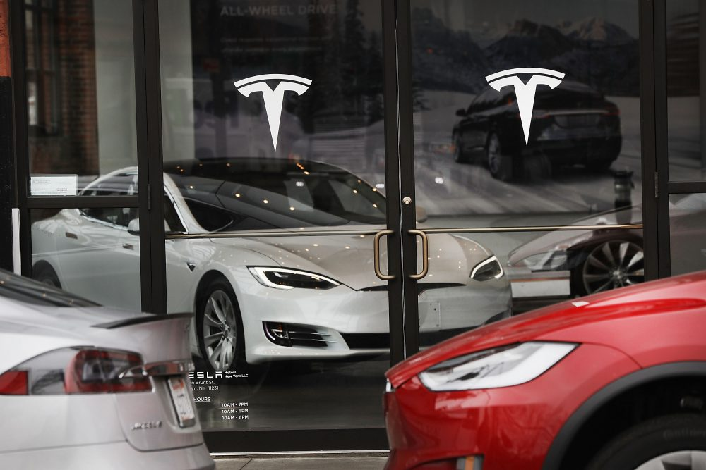 a tesla car is displayed in a showroom at a brooklyn tesla dealership on april 4