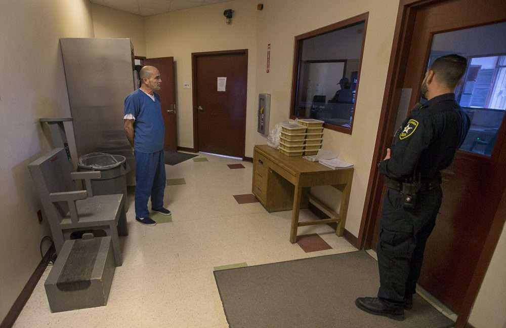 Alptekin waits to be frisked before returning to his cell at the Bristol County House of Corrections. (Jesse Costa/WBUR)