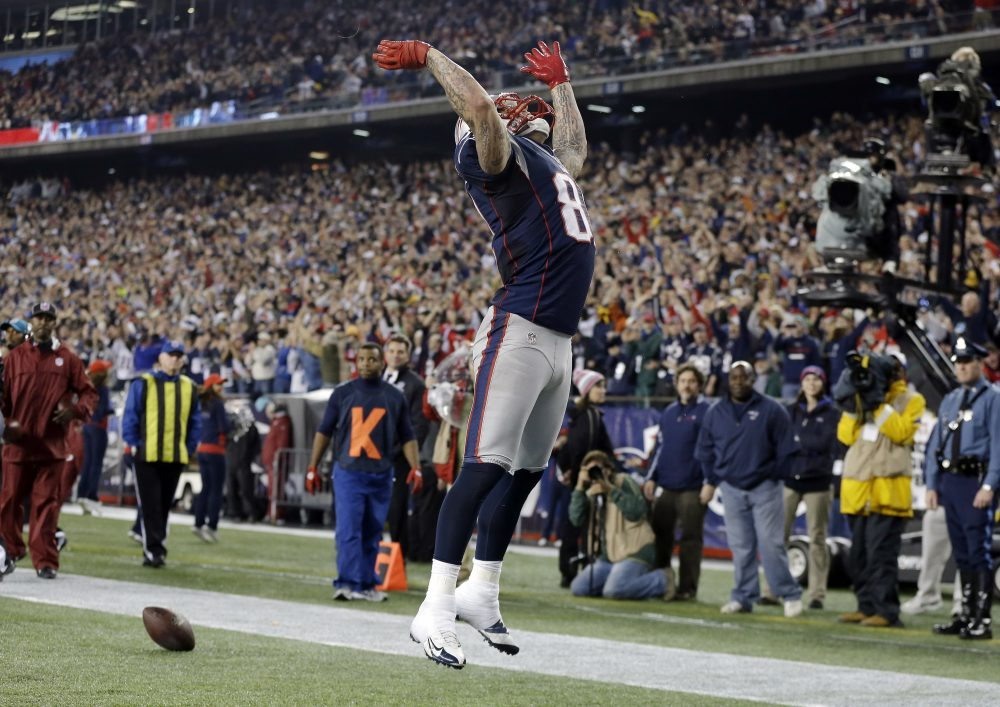 Patriots tight end Aaron Hernandez celebrates his touchdown catch against the Texans on Dec. 10, 2012. (Elise Amendola/AP)