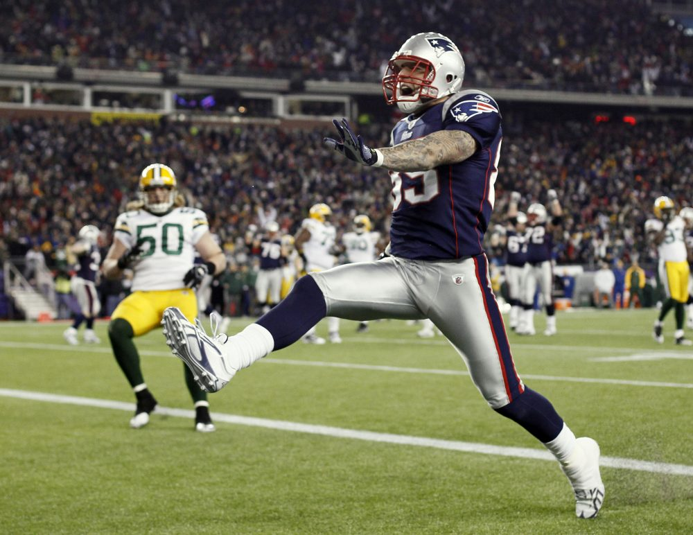 Patriots tight end Aaron Hernandez high steps into the end zone during the fourth quarter of New England's 31-27 win against the Packers on Dec. 19, 2010. (Winslow Townson/AP)