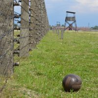 "Kevin Simpson chronicles the history of soccer, survival and resistance during the Holocaust in his book ""Soccer Under the Swastika."" Above is a photo he took at the Auschwitz concentration camp. (Kevin Simpson)"