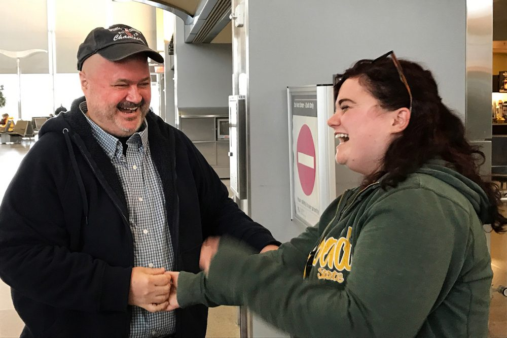 Sean Bunn and his daughter Niki Ilse meet for the first time at the Raleigh-Durham Airport in March. (Photo by Marion Bunn)