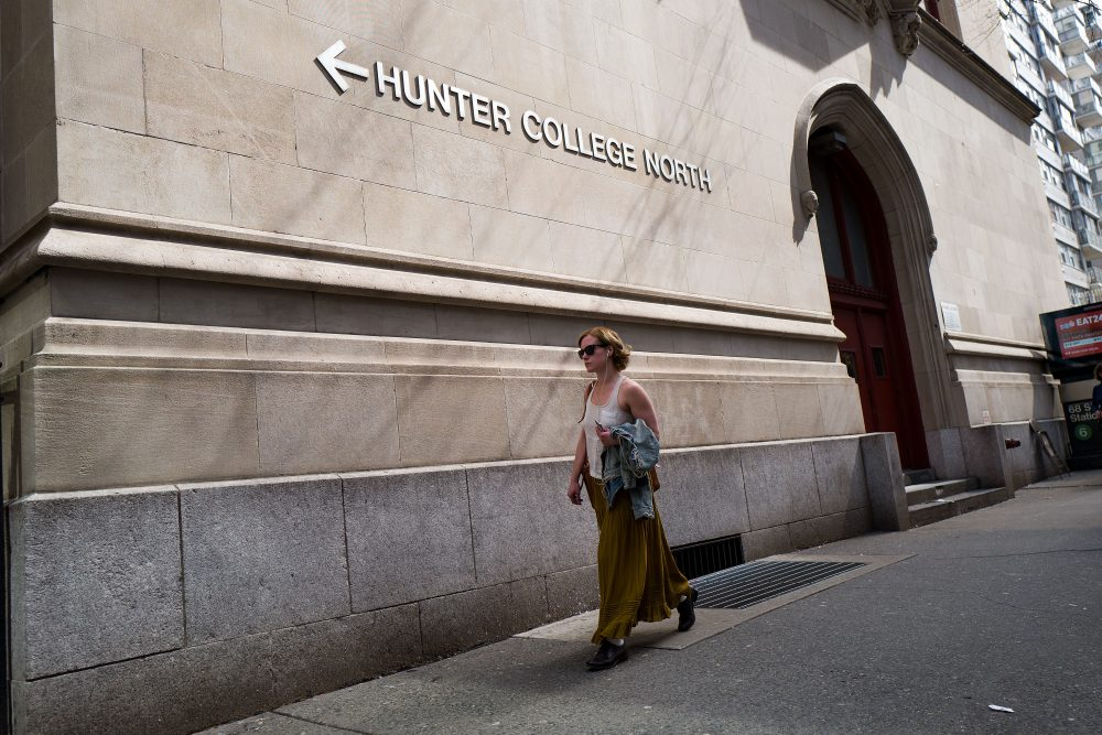 A woman walks along 68th Street on the campus of Hunter College of The City University of New York, April 10, 2017 in New York City. Following a state budget approval on Sunday, New York will be the first state to make public colleges and universities free for qualified middle-class students with a family income under $125,000. (Drew Angerer/Getty Images)