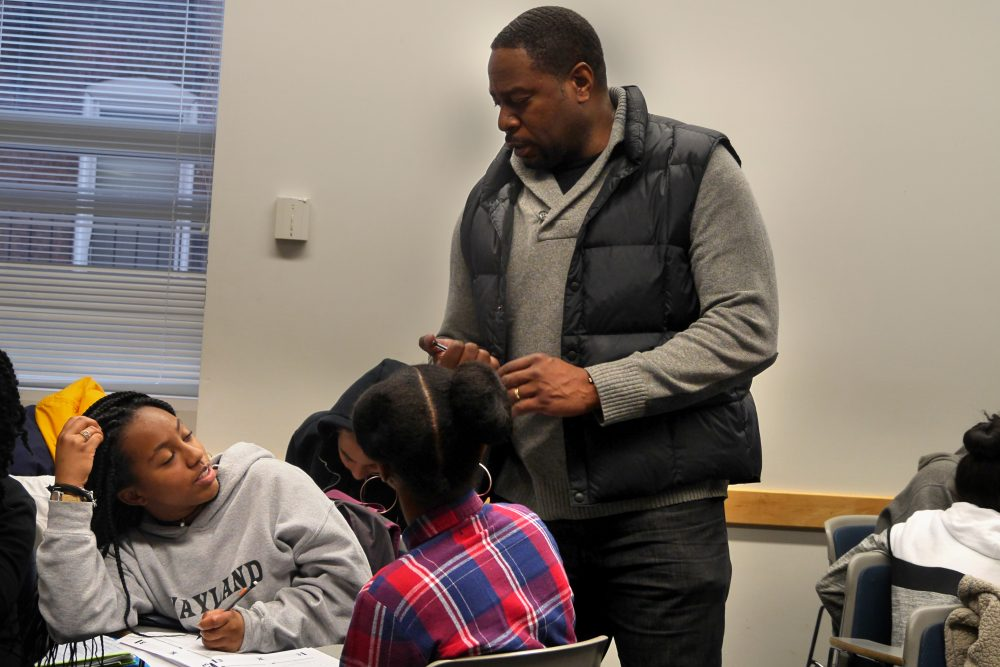 Adrian Mims speaks to students during a Calculus Project session at Boston University. (Max Larkin/WBUR)