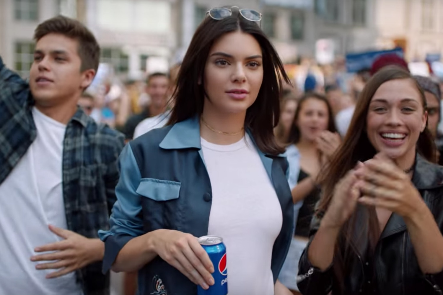 Model Kendall Jenner appears in a still from a controversial advertisement for Pepsi, which the company pulled after widespread criticism of the ad's content. (Pepsi)