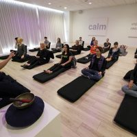 , Lauren Eckstrom, left, begins a session at Unplug Meditation Center in Los Angeles. (Nick Ut/AP)