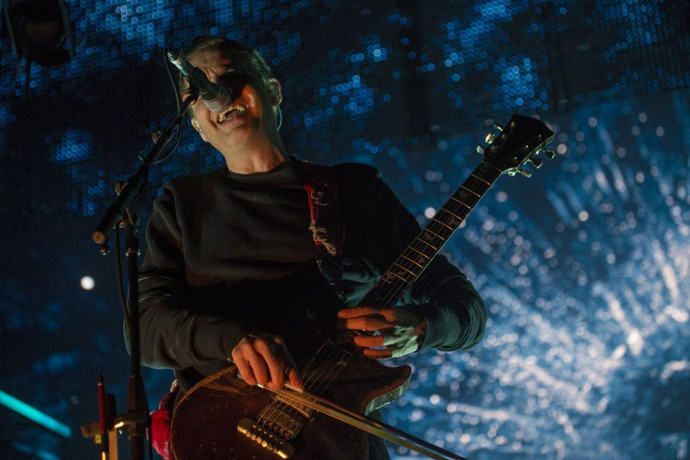 Jónsi, of Icelandic post-punk band Sigur Rós, plays a guitar with a violin bow. (Jesse Costa/WBUR)
