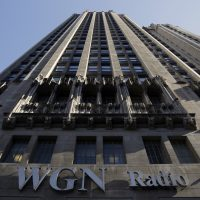 The WGN Radio sign appears on the side of Tribune Tower, Monday, May 1, 2017, in downtown Chicago. TV station operator Tribune Media is at the center of a possible bidding war, following reports that Fox News owner 21st Century Fox and investment firm Blackstone may make a joint takeover bid for the company. (Kiichiro Sato/AP)