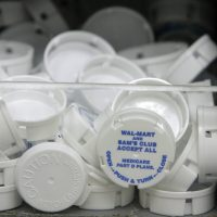 Tops to prescription bottles are pictured inside the Wal-Mart pharmacy Sept. 22, 2006 in Clearwater, Fla. (Robert Sullivan/AFP/Getty Images)