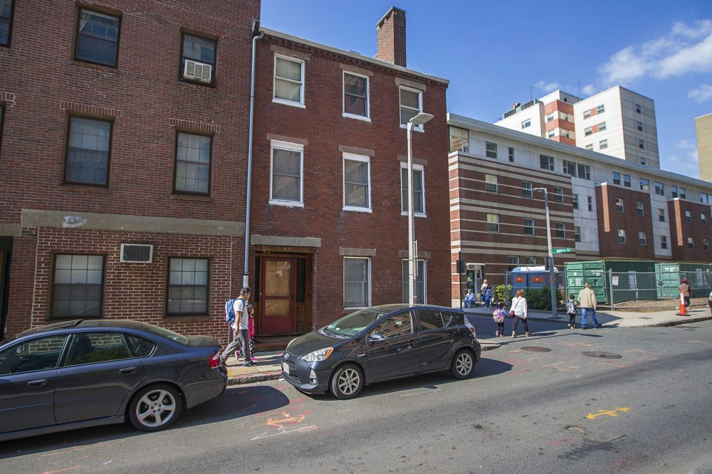 Amid a booming real estate market, organizers at the Chinatown Community Land Trust are battling to keep their neighborhood the bastion for working class Chinese immigrants it's been for more than 100 years. The group tried to purchase this row house at 29 Oak Street, but they were outbid by a developer. (Jesse Costa/WBUR)