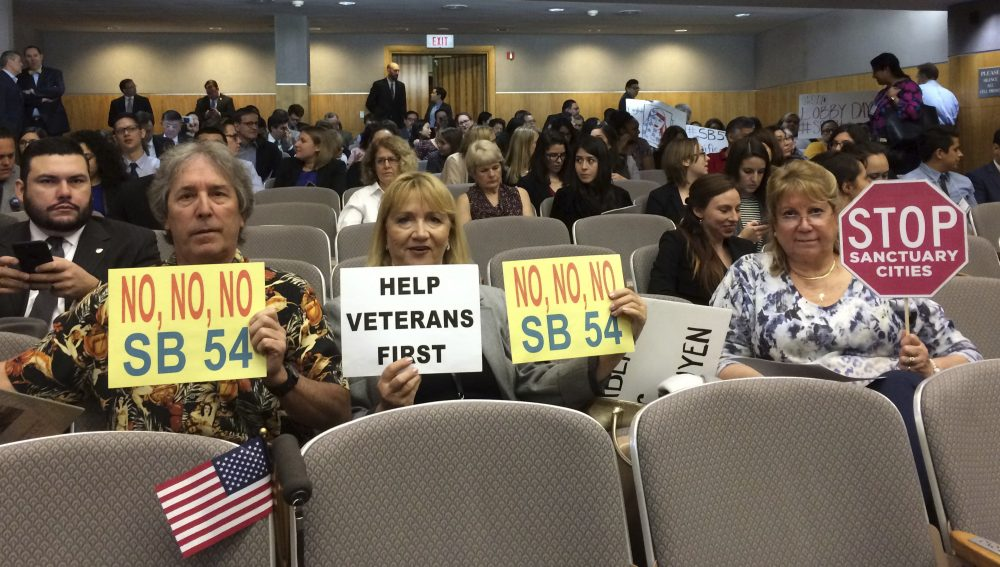 Here, opponents of a California proposal that would create a statewide sanctuary for immigrants in the country illegally prepare to testify before lawmakers in Sacramento. Massachusetts lawmakers are considering a similar proposal. (Don Thompson/AP)