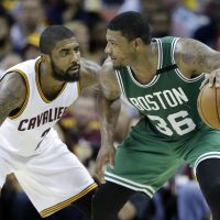 Boston Celtics' Marcus Smart (36) looks to drive on Cleveland Cavaliers' Kyrie Irving (2) during the second half of Game 3 on Sunday. (Tony Dejak/AP)