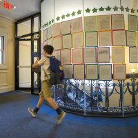 A student walks by essays at the Landmark School in Manchester-By-The-Sea. (Jesse Costa/WBUR)
