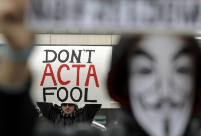 Protesters hold banners during a protest against the Anti-Counterfeiting Trade Agreement, or ACTA, in Sofia, Saturday, Feb. 11, 2012. Protesters gathered in several European cities Saturday to voice anger at an international copyright treaty that they fear will lead to censorship on the Internet. (Valentina Petrova/AP)