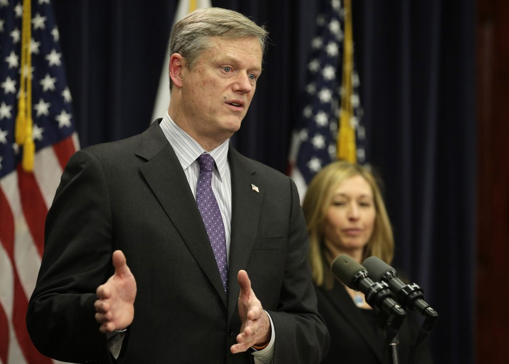 Gov. Charlie Baker takes questions from members of the media as Secretary of Administration and Finance Kristen Lepore looks on during a January news conference. (Steven Senne/AP)