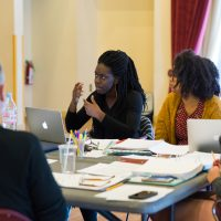 "Obehi Janice working on her play ""Ole White Sugah Daddy"" with dramaturg Phaedra Michelle Scott and others. (Courtesy Maggie Hall Photography)"