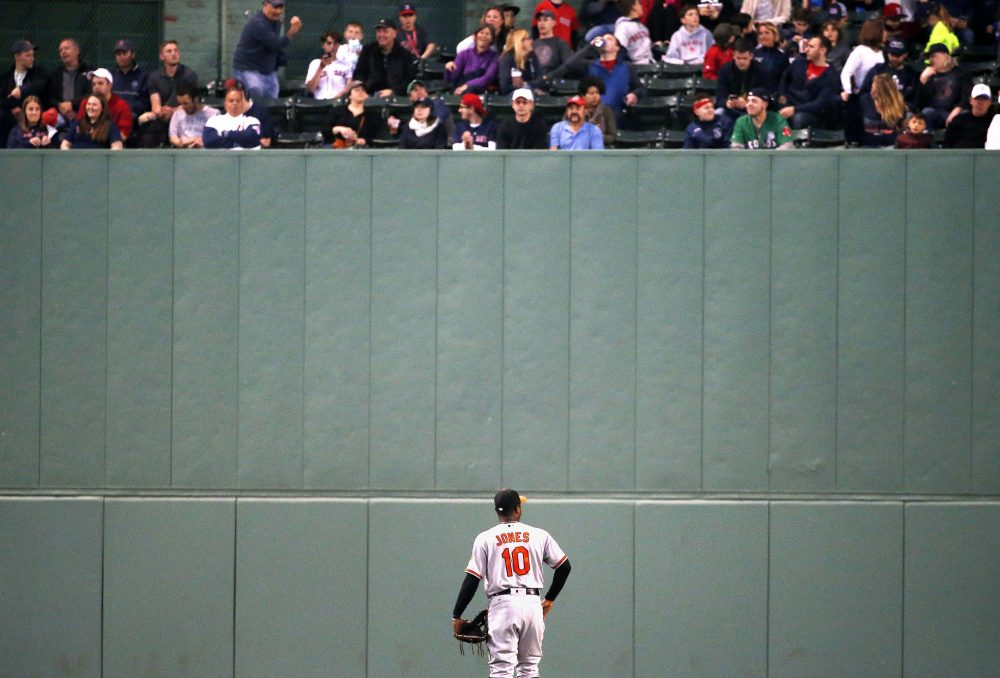 Baltimore Orioles' Adam Jones looks up at fans during a baseball game against the Red Sox, Tuesday, May 2, 2017, at Fenway. (Michael Dwyer/AP)