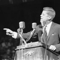 "Sen. John F. Kennedy at a Boston Garden rally on Nov. 7, 1960. The Democratic presidential candidate pledged to strengthen the nation's military power ""to the point where no aggressor will dare attack."" (AP Photo)"