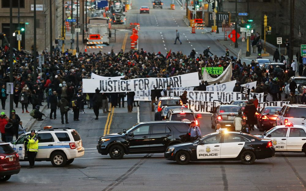 Hundreds of Black Lives Matter demonstrators occupy the street in front of the federal building, Tuesday, Nov. 24, 2015, in Minneapolis. (Jim Mone/AP)