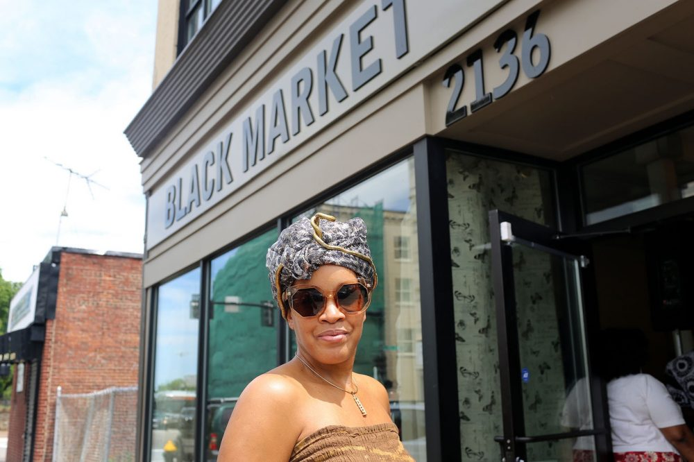 Kai Grant is the owner and curator of Black Market in Dudley Square. (Hadley Green for WBUR)