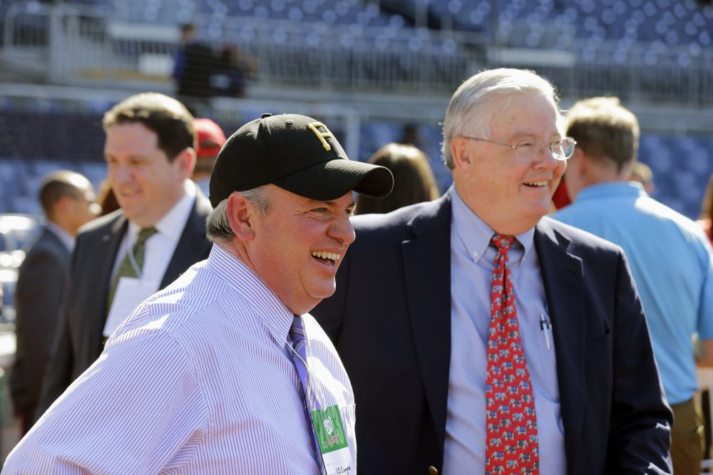 They may be from different parties but a love of the national pastime has brought Reps. Mike Doyle (D-Pa.), at left, and Joe Barton (R-Texas) together. The two managers of the congressional baseball squads are seen here catching a pro game at Nationals Park. (Alex Brandon/AP)