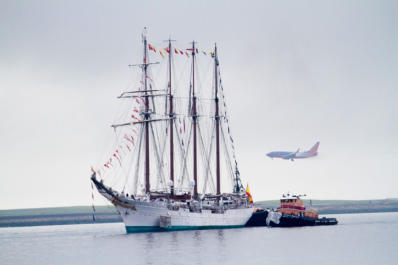 The Spanish Tall Ship Juan Sebastian de Elcano is escorted into Boston Harbor in 2015. (Jesse Costa/WBUR)