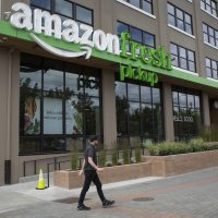 A man walks past an AmazonFresh Pickup location on June 16, 2017 in Seattle. Amazon announced that it will buy Whole Foods Market, Inc. for over $13 billion. (David Ryder/Getty Images)