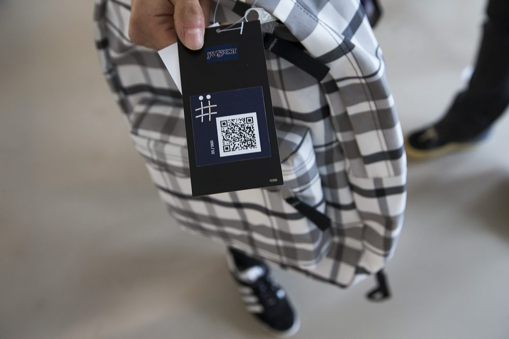 A JanSport backpack capable of storing information in its fabric that can then be accessed using an app on a smartphone. The QR code here allows the backpack owner to connect their bag to the AFFOA Looks app. Then other people with the app can scan the backpack itself and see what the backpack owner has uploaded. (Jesse Costa/WBUR)