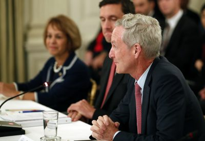 Tom Leighton, CEO of Akamai, right, speaks during an American Technology Council roundtable in the State Dinning Room of the White House on Monday in Washington. (Alex Brandon/AP)