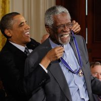 Former U.S. President Barack Obama presents Basketball Hall of Famer and human rights advocate Bill Russell the 2010 Medal of Freedom. (Chip Somodevilla/Getty Images)