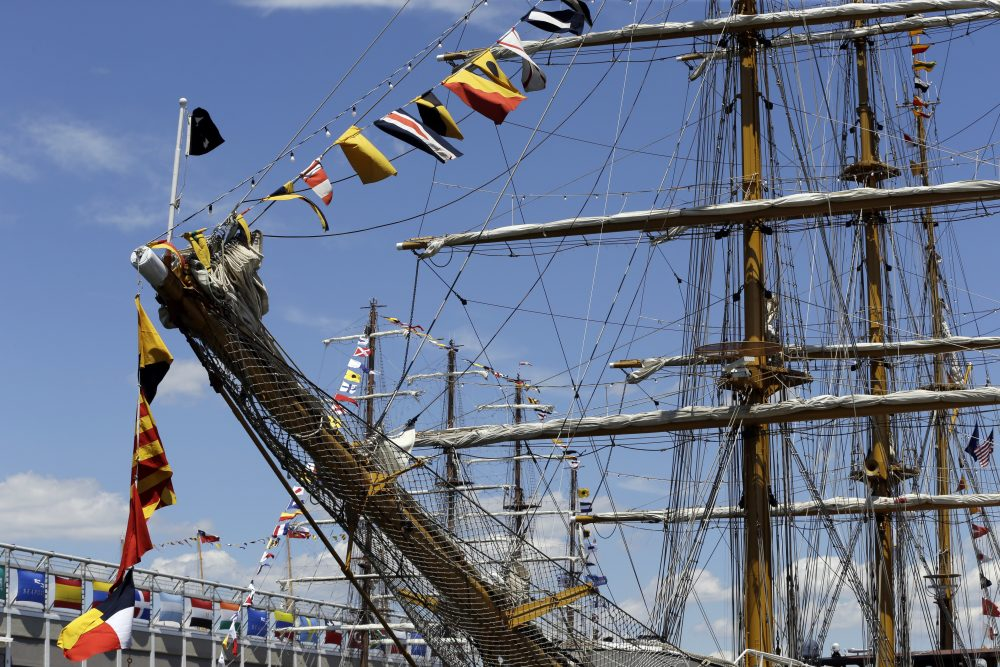 Flags fly on tall ships that are docked in Boston on Wednesday. More than 50 tall ships from Europe, South America and the U.S. converged on the city as part of the Rendez-Vous 2017 Tall Ships Regatta. (Elise Amendola/AP)