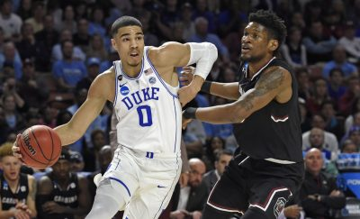 Jayson Tatum, as a student at Duke in March 2017, drives past South Carolina's Chris Silva during a NCAA game. (Rainier Ehrhardt/AP)