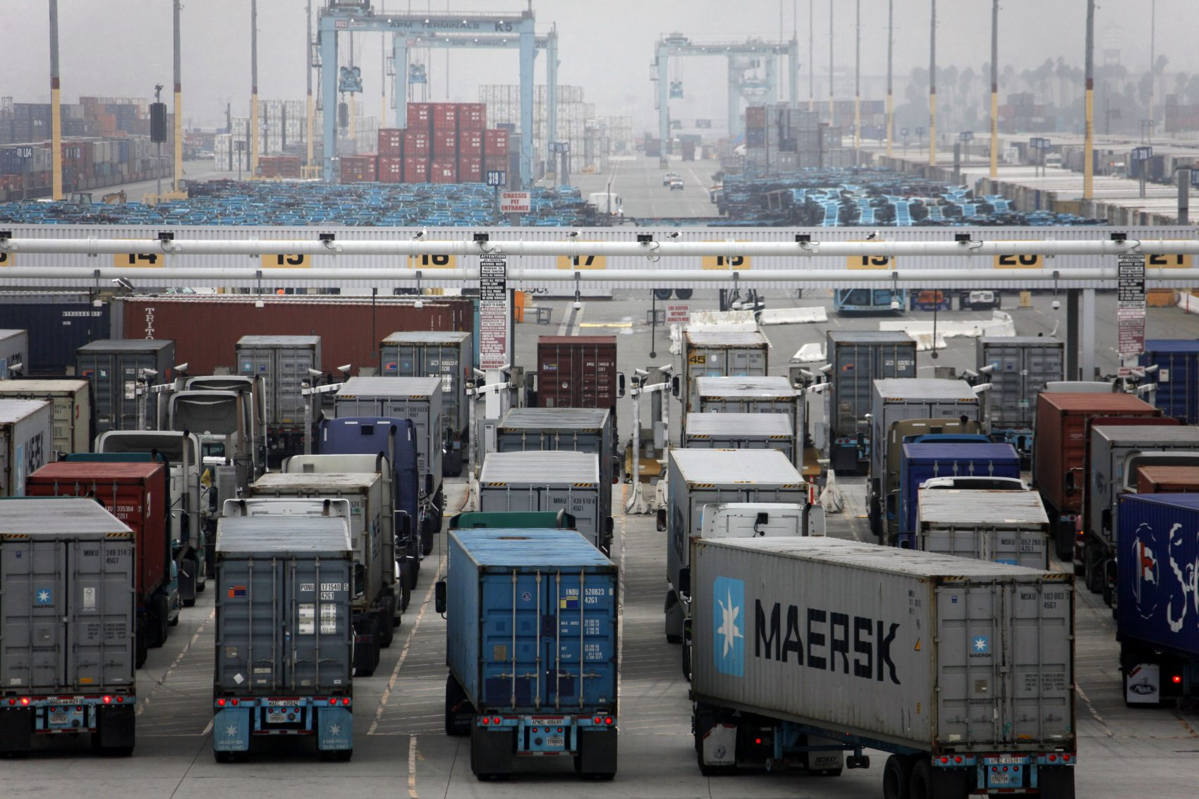 Trucks wait to be loaded at the Port of Los Angeles in 2012. (Nick Ut/AP)