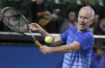 "In his new book, ""But Seriously,"" a more nuanced John McEnroe emerges: a calmer, more introspective and at times sentimental version of his still-opinionated self. Pictured: McEnroe returns a shot during a charity tennis match in Tokyo in 2013. (Shizuo Kambayashi/AP)"