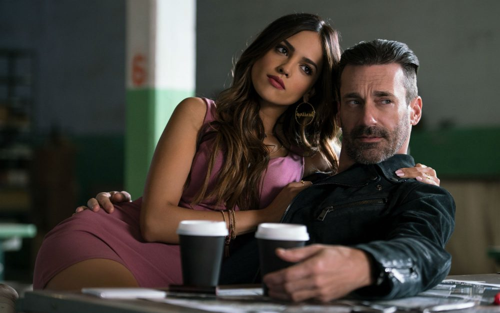 "Buddy, played by Jon Hamm, and Darling, played by Eiza Gonzalez, find out why Baby always listens to music in ""Baby Driver."" (Courtesy Sony)"