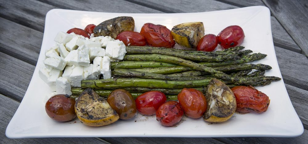 Kathy's grilled asparagus with grilled lemon, grilled tomatoes and feta cheese. (Robin Lubbock/WBUR)