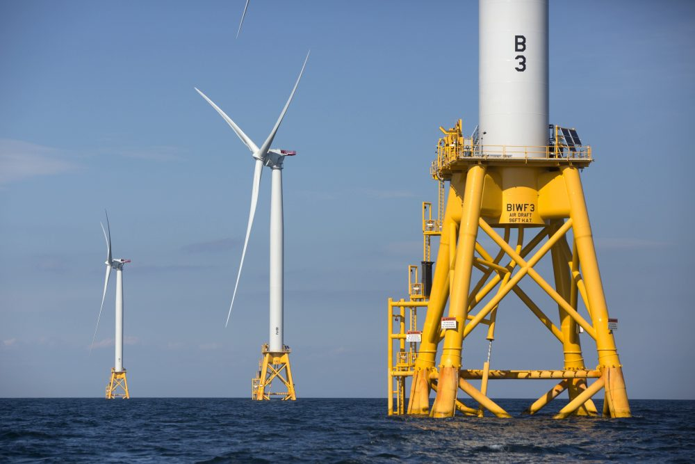 Three wind turbines from the Deepwater Wind project off Block Island, Rhode Island, as seen in August 2016. Massachusetts is slated to start spinning at its own offshore wind farm off the coast of Martha's Vineyard in a couple years. (Michael Dwyer/AP)
