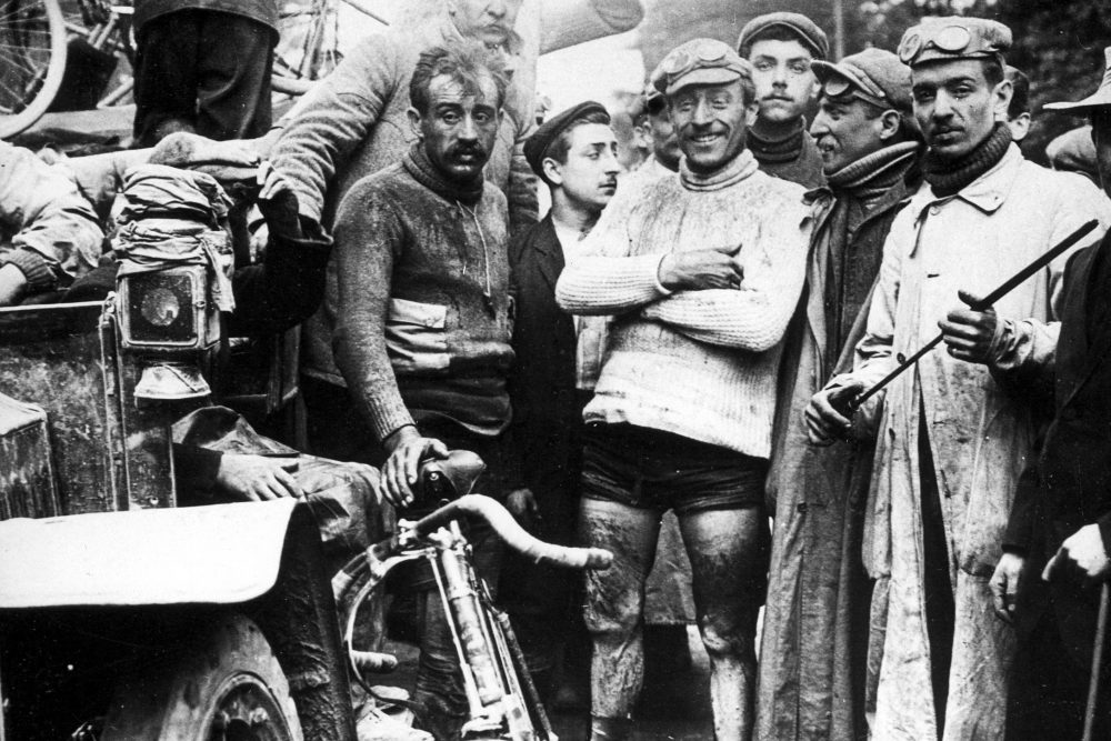 Encrusted with dirt, Maurice Garin smiles at a stage finish. Rival Léon Georget (left) appears completely spent. (Spaarnestad Photo)