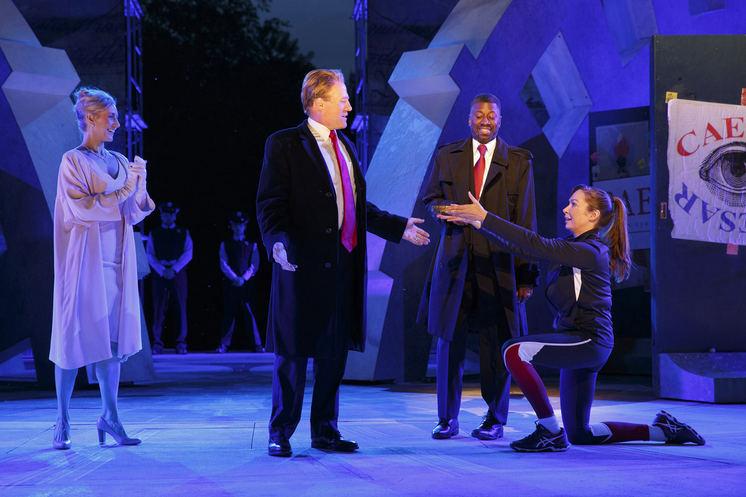 Tina Benko, left, portrays Melania Trump in the role of Caesar's wife, Calpurnia, and Gregg Henry, center left, portrays President Donald Trump in the role of Julius Caesar during a dress rehearsal of The Public Theater's Free Shakespeare in the Park production of Julius Caesar in New York. (Joan Marcus/The Public Theater via AP)