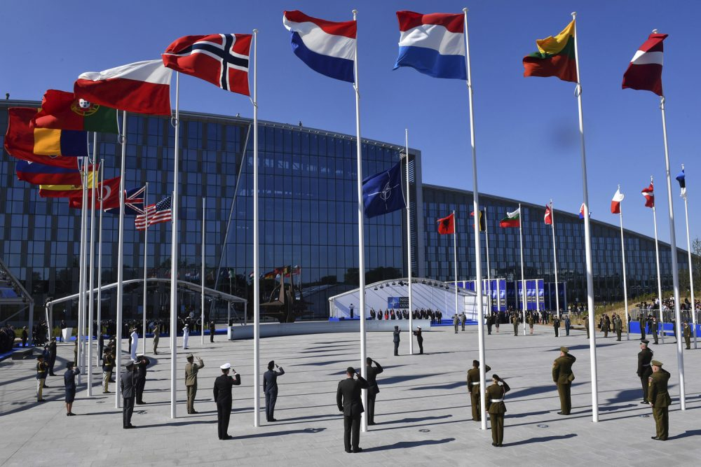 Flags of NATO member countries flutter during a handover ceremony at the NATO summit in Brussels on Thursday, May 25, 2017. (Geert Vanden Wijngaert, Pool/AP)